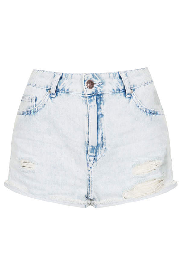 Topshop Moto high waisted hallie short in bleach extracted wash and rip detailing. 100% cotton. machine washable.