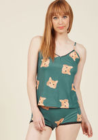 YMSP02SK As evening draws near, you have a choice to make - head out, or slip into these comfy cat pajamas? Reviewing the muted blue-green hue, black lace trimmings, and orange kitty visages of this ModCloth-exclusive, cami-and-boyshorts set, you decide that quirk