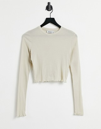 Weekday Sena long sleeve top with lettuce edge in light beige