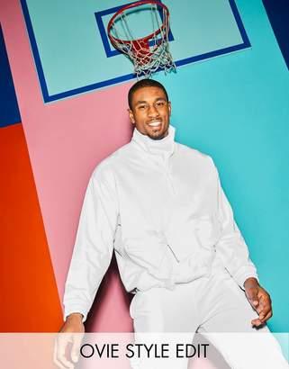 Asos DESIGN two-piece oversized sweatshirt with half zip & nylon utility bellow pockets in white