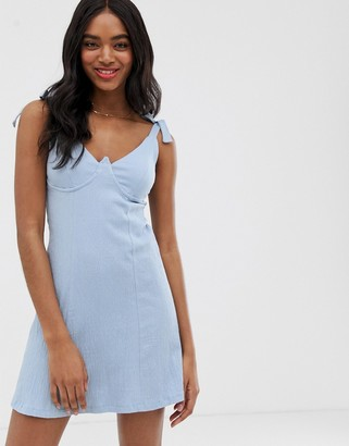 ASOS DESIGN cupped mini textured sundress with tie straps