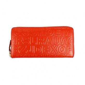 Comme des Garcons Orange Leather Wallets