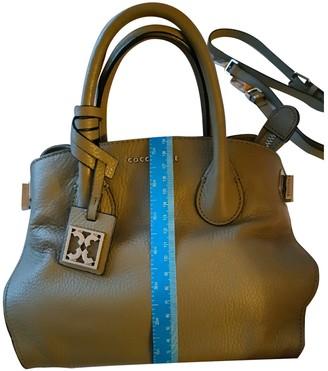 Coccinelle Khaki Leather Handbags