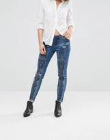 Blank NYC Print Slim Jeans with Ripped Knees and Raw Hem