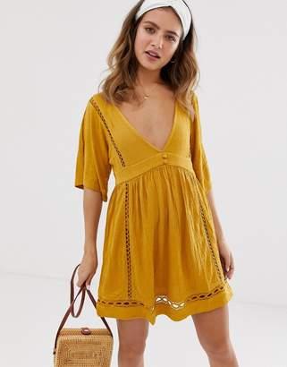 Asos Design DESIGN slubby mini dress with ladder trims