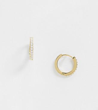 Orelia huggie hoop earrings with white crystals in gold plate