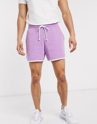 ASOS DESIGN oversized jersey runner shorts in purple with white binding
