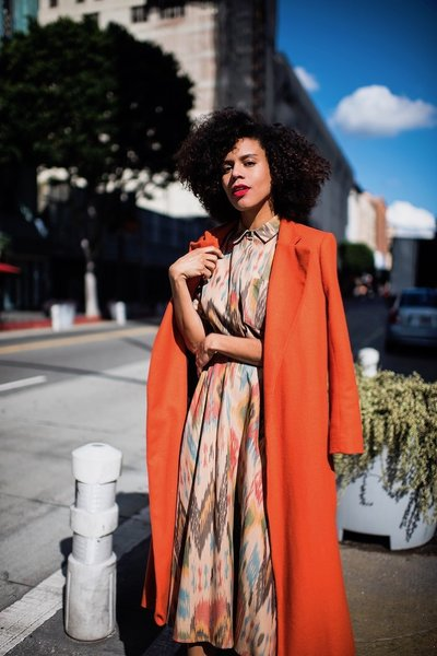 t, long orange coat that pairs perfectly with a nice print top + skirt set. #orangecoat #spring #ootd #blogger #stylemegrasie
