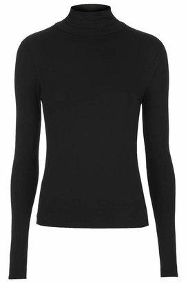 Topshop Long sleeved jersey basic with roll neck. 94% viscose, 6% elastane. machine washable.