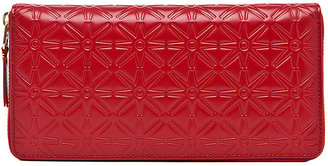Comme des Garcons Star Embossed Long Wallet in Red   FWRD