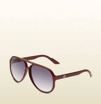 Gucci medium aviator sunglasses with G detail and signature web on temple.