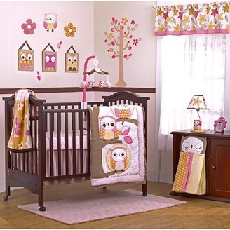 The Woods Cocalo baby in bedding coordinates