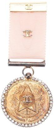 Chanel medal brooch