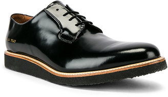 Common Projects Leather Derby Shine in Black | FWRD