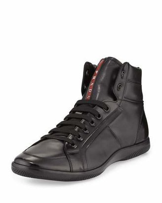 Prada Napa Leather High-Top Sneaker, Black $695 thestylecure.com
