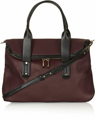 Topshop Slouchy fold-over holdall with zip-top fastening, double grab handle and detachable shoulder strap. h:31cm w:42cm. 100% polyurethane. specialist clean only.