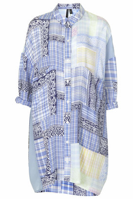 Topshop Silk shirt dress in a navy and pastel tone patchwork print. cut in a relaxed silhouette, with full length button placket and chest pocket. slip on a pair of sliders