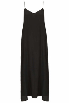 Topshop Silk midi length slip in swing shape with skinny straps. style it with chunky, cleated sole heels