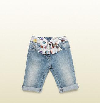 Gucci light blue stretch denim pant with script cupcake print belt