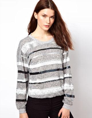 Aryn K Oversized Sweater In Sequin Stripe