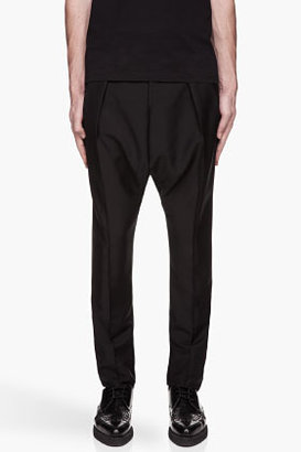 Givenchy Black pleated low-rise wool-mohair blend trousers