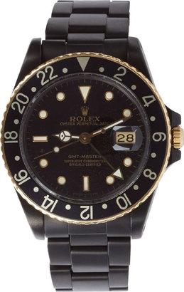 Black Limited Edition Matte Black & Gold Limited Edition Rolex GMT Master I $23,750 thestylecure.com