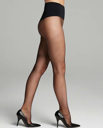 Commando Very Fine Fishnet Tights $36 thestylecure.com