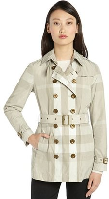 Burberry beige and ivory nylon nova check belted long sleeve trench coat