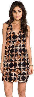Indah Riva Deep V-neck T-back Sleeveless Mini Dress