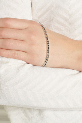 Silver-plated pyramid hand cuff