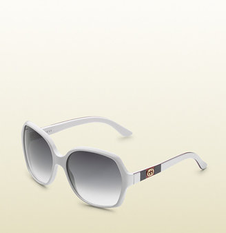 Gucci hexagonal frame sunglasses with GG logo and web on temples.