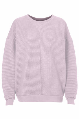 Topshop Contrasting directional ribbed texture sweatshirt cut with a round neck and raglan sleeves in a loose, slightly oversized fit. wear it with ripped jeans