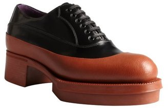 Prada black and orange leather oxfords with angular mid-sole
