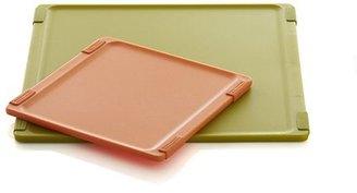 Crate & Barrel Jelli® Orange Nonslip Reversible Cutting Board.