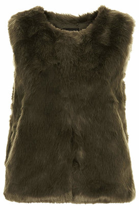 Topshop All over faux fur gilet with front hook and eye fastening. concealed side pockets. 100% modacrylic. dry clean only. length 60cm.
