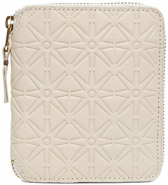 Comme des Garcons Star Embossed Zip Fold Wallet in Off White | FWRD