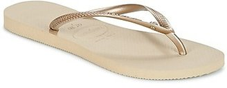 Havaianas SLIM CRYSTAL GLAMOUR women's Flip flops / Sandals (Shoes) in Gold