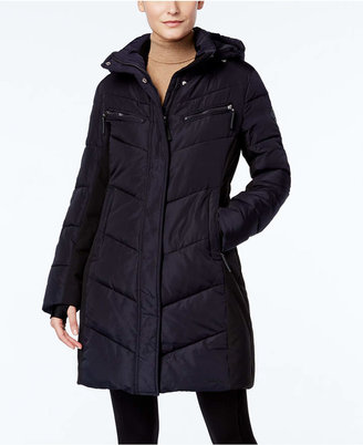 Calvin Klein Hooded Water-Resistant Puffer Coat $280 thestylecure.com