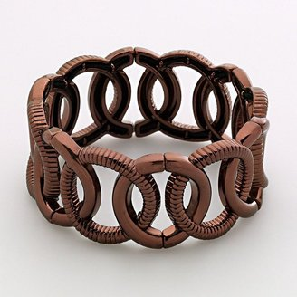 Dana Buchman bronze tone circle stretch bracelet