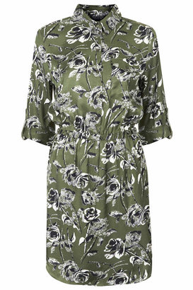 Topshop Cotton shirt dress in all-over floral print. cut with a half button placket, elasticated waist and handy side pockets. 100% cotton. machine washable.