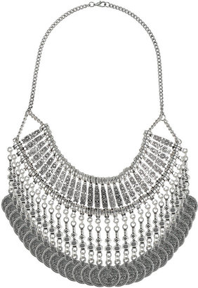 Topshop Freedom at 100% metal. Silver look ethnic patterned necklace with multiple coins hanging from the bottom, length 11.25 inches.