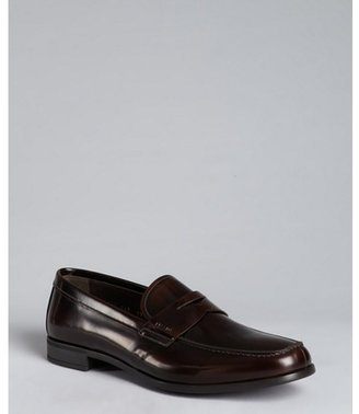 Prada burnt leather penny loafers