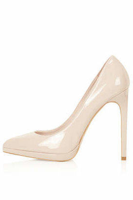 "Topshop Patent nude platform court shoe with pointed toes. heel height approximately 5"". 100% synthetic."
