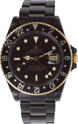 Black Limited Edition Matte Black & Gold Limited Edition Rolex GMT Master I $23,750 thestylecure.com