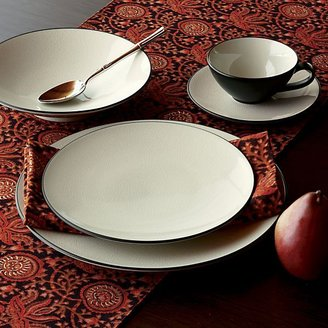 Crate & Barrel Kita 16-Piece Set: four 4-piece place settings.