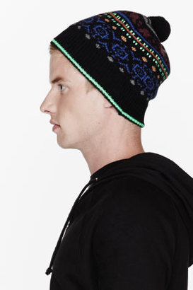 Paul Smith & green patterned pom-pom beanie
