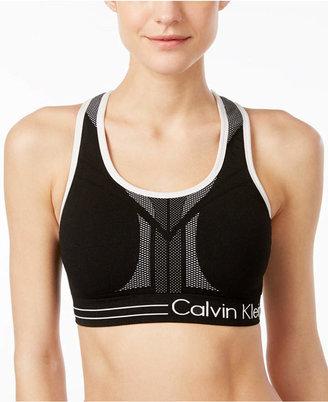 Calvin Klein Performance Reversible Mid-Impact Racerback Sports Bra $24.98 thestylecure.com