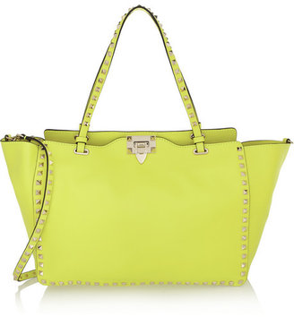 Valentino The Rockstud medium neon leather trapeze bag