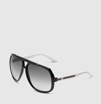 Gucci large aviator sunglasses with G detail and signature web on temple.