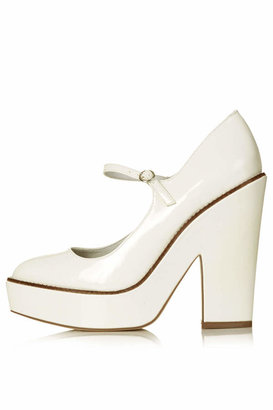 """Topshop White leather-look chunky platforms with rounded toe and ankle fastening. heel height 5"""". 100% polyurethane."""